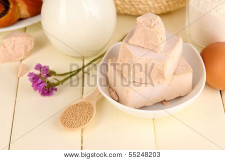 Dry yeast with pastry and baking ingredients on wooden table close-up