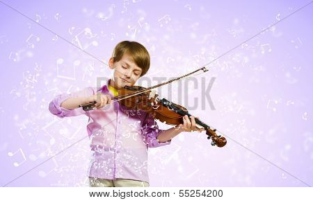 Image of little cute boy playing on violin against color background