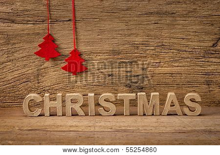 The word christmas in front of a rustic background