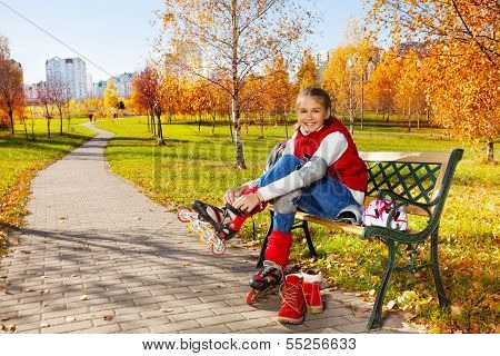 Cute Girl Putting On Roller Blades