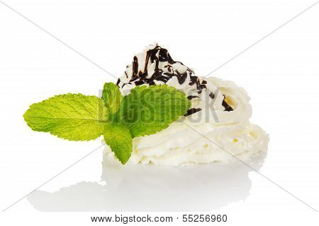 The hill of whipped cream decorated with chocolate