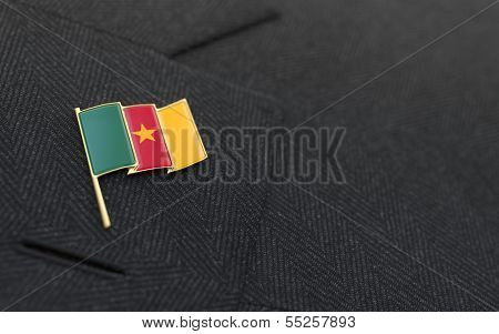 Cameroon Flag Lapel Pin On The Collar Of A Business Suit