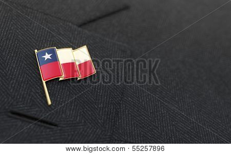 Chile Flag Lapel Pin On The Collar Of A Business Suit