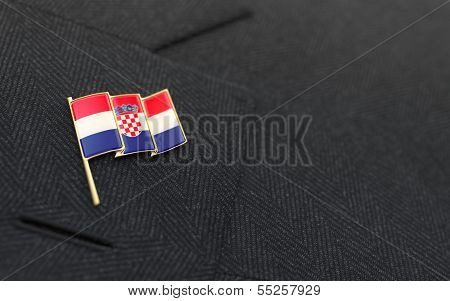Croatia Flag Lapel Pin On The Collar Of A Business Suit