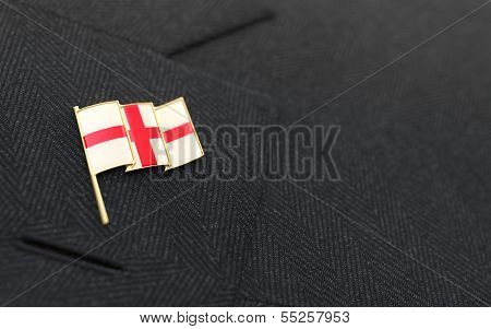 England Flag Lapel Pin On The Collar Of A Business Suit