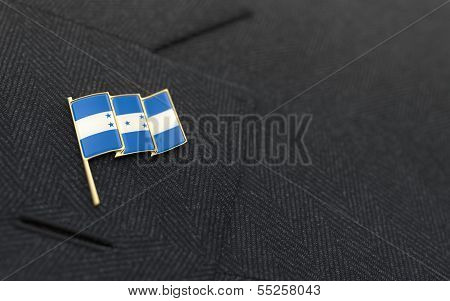 Honduras Flag Lapel Pin On The Collar Of A Business Suit
