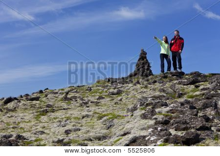 Couple Climbing A Mountain Together