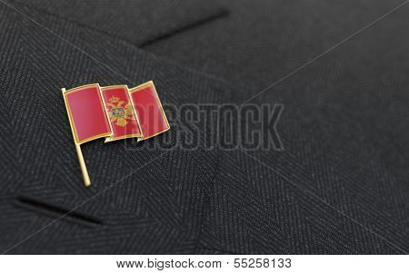 Montenegro Flag Lapel Pin On The Collar Of A Business Suit