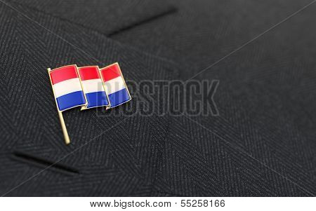 Netherlands Flag Lapel Pin On The Collar Of A Business Suit