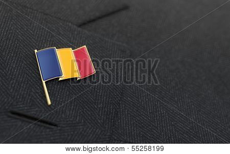 Romania Flag Lapel Pin On The Collar Of A Business Suit