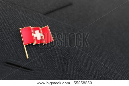 Switzerland Flag Lapel Pin On The Collar Of A Business Suit