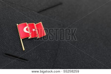 Turkey Flag Lapel Pin On The Collar Of A Business Suit