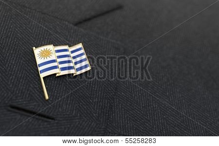 Uruguay Flag Lapel Pin On The Collar Of A Business Suit