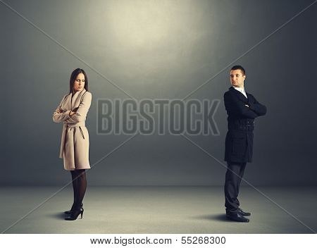 sorrowful man and woman in quarrel