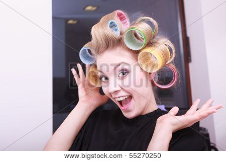 Cheerful Funny Blond Girl Hair Curlers Rollers By Haidresser In Beauty Salon