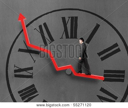 Businessman Walking On Growth Red Arrow With Chock Face In Concrete Wall Background