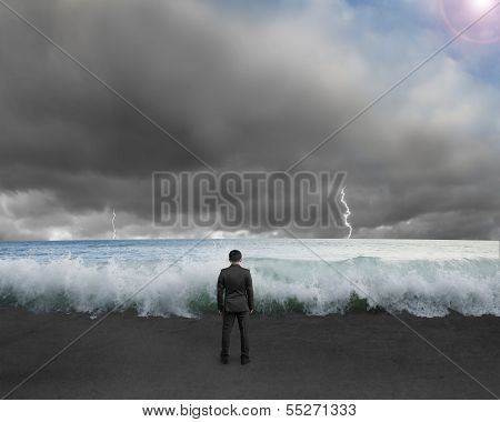 Businessman Standing Toward Waves And Cludy Sky With Lightning , Thunder To Challenge Dangerous Situ