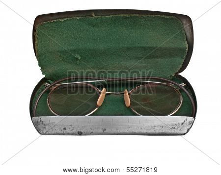 vintage round glasses in the case over white
