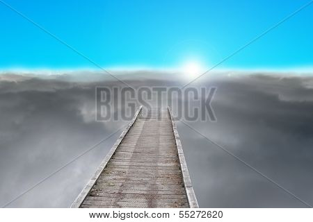 Wooden Pier With Sunrise, Dark Clouds And Blue Sky