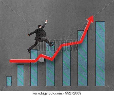 Businessman Running And Jumping On Growth Red Arrow With Chart