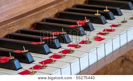 Thumbtack On Piano Keys Making It Difficult Or Painful To Play Music.