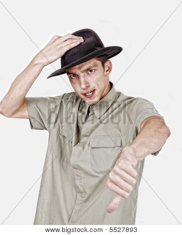 Young Man With Hat On Head And Thumb Down