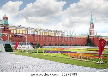 MOSCOW - JULY 19: Flowers at Red Square at 120 anniversary of GUM, on July 19, 2013 in Moscow, Russia.  GUM is large shopping complex, which occupies entire block and is main facade of Red Square.
