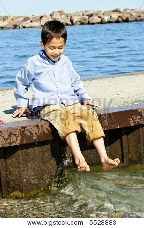 Boy Playing On Pier