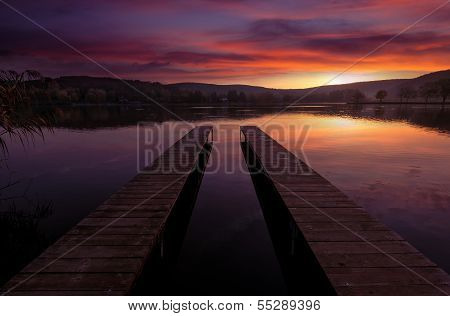 Mystical Landscape two long pier at dawn