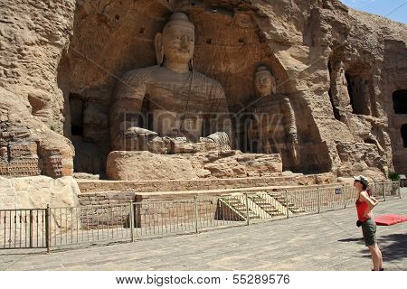 A Western Tourist Looks At The Great Buddha Of The Yungang Grottoes