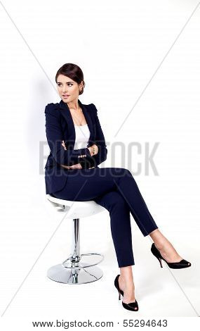 Happy successful business woman in office chair on white background