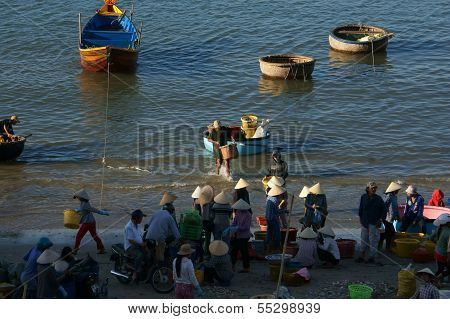 People Buy And Sale Seafood At Market On Baach