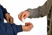 stock photo of sachets  - A drug dealer sells drugs to his client - JPG