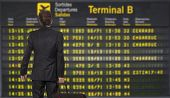 image of time flies  - Businessman with a briefcase on a background of departure board at airport  - JPG