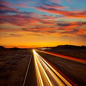 picture of nightfall  - Arizona sunset at Freeway 40 with cars light traces USA - JPG