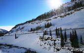 stock photo of mola  - Sun is shining down Molas Pass in CO - JPG