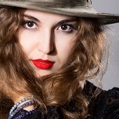 Brown-haired Beautiful Girl In A Hat With Contact Lenses.