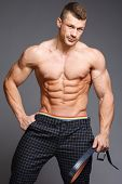 stock photo of jock  - The beautiful and strong muscular young guy - JPG