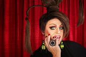 picture of drag-queen  - Beautiful drag queen staring and biting nails - JPG
