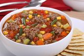 stock photo of vegetable soup  - Closeup of a bowl of vegetable beef soup - JPG