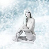 image of snow queen  - Light winter fashion portrait of sexy beautiful woman  - JPG