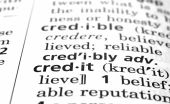 stock photo of debenture  - The word Credit in a dictionary close - JPG