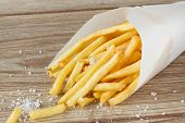picture of crisps  - french fries potato  with salt on wooden table - JPG