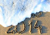 stock photo of happy new year 2013  - Happy New Year 2014 replace 2013 concept on the sea beach - JPG