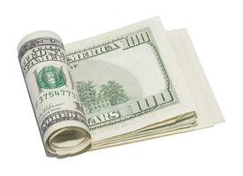 stock photo of one hundred dollar bill  - Roll of 100 dollar bills isolated on white - JPG