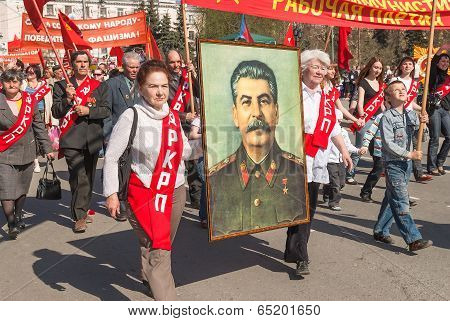 Members of KPRF with Stalin's portrait on parade