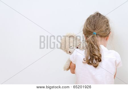 Little Girl Crying In The Corner. Domestic Violence Concept.