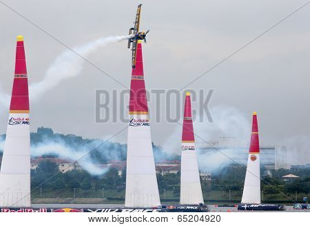 PUTRAJAYA, MALAYSIA - MAY 17, 2014: Nigel Lamb of Great Britain, in a MXS-R plane flies past the pylons at the qualifying session of the Red Bull Air Race World Championship 2014.
