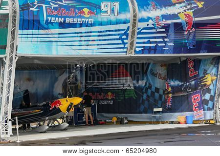 PUTRAJAYA, MALAYSIA - MAY 16, 2014: Unidentified mechanics from Peter Besenyei's hangar prepare his plane for a training session during the Red Bull Air Race World Championship Putrajaya 2014.