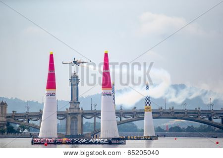 PUTRAJAYA, MALAYSIA - MAY 16, 2014: Nigel Lamb, Great Britain in a MXS-R plane flies between the pylons during a training session preparing for the Red Bull Air Race World Championship Putrajaya 2014.